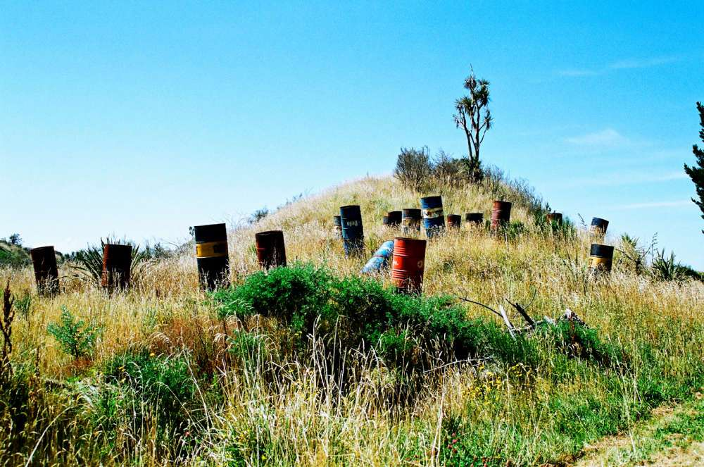44-gallon-drums-on-a-hillside-near-sandy-point.jpg