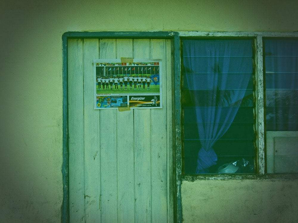 A poster of the Fiji Olympic Gold Medal winning Sevens team on the door of a cottage in Votua village