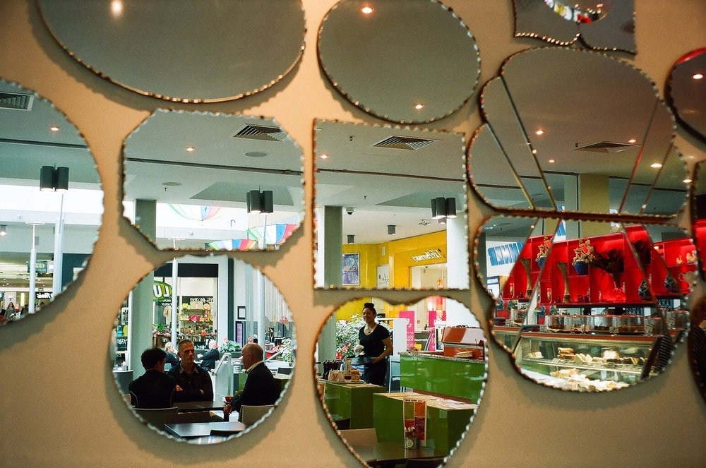 Reflections on a cafe wall, Dunedin