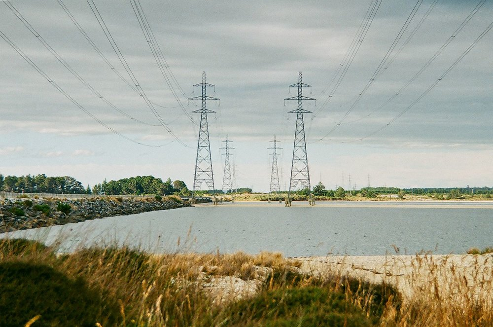 Power pylons wind their way towards the Tiwai Point aluminium smelter