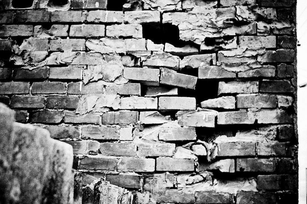 24-just-another-brick-in-the-wall-crumbling-brick-wall-black-and-white-noir-style.jpg