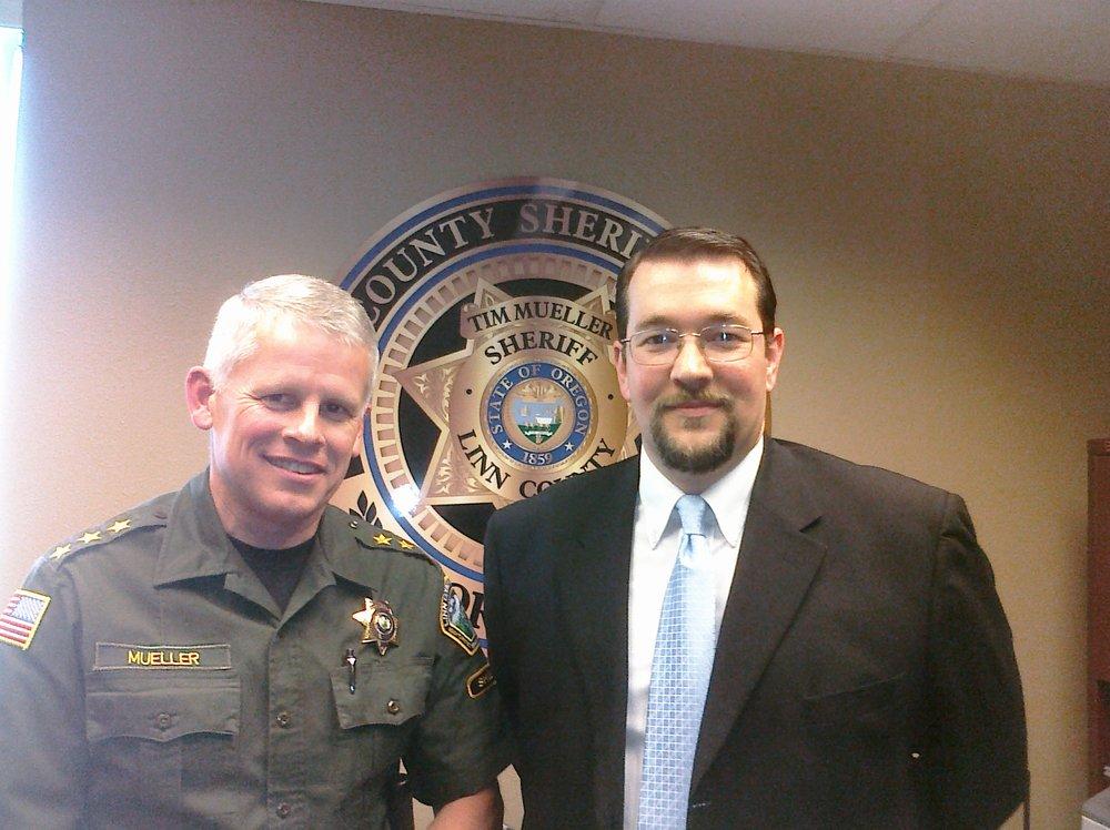 Retired Linn County Sheriff Tim Mueller and Michael Wynhausen
