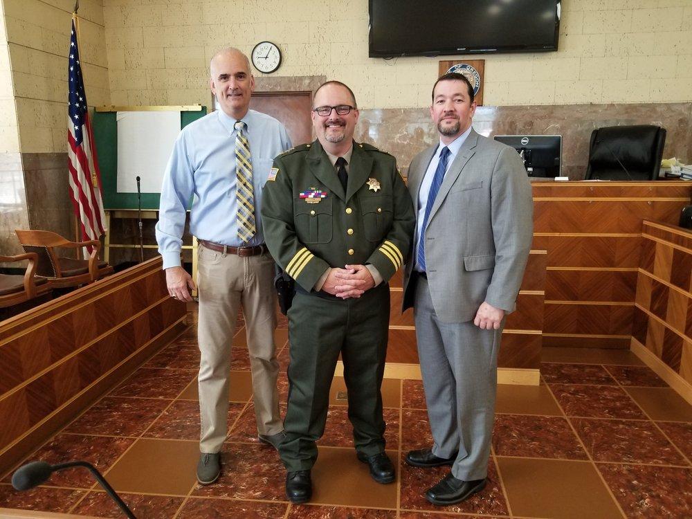 Retired Linn County Sheriff Bruce Riley, Linn County Sheriff Jim Yon, and Michael Wynhausen