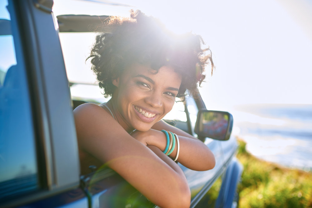 Woman leaning out of car window.jpg