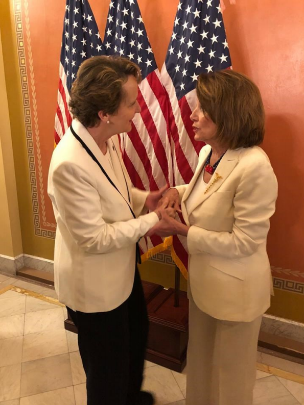 Mary Kay Henry holding hands with Nancy Pelosi before Trump's State of the Union speech.