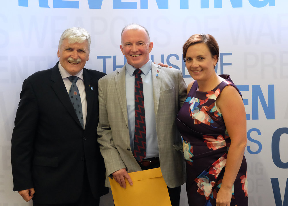 Dr. Ian MacVicar graduated from the Veteran Trainers to Eradicate Child Soldiers (VTECS) program on 27 July 2017. He is flanked by Lieutenant-General Roméo Dallaire, founder of the Dallaire Initiative (LEFT) and Dr. Shelly Whitman, CEO of the Dallaire Initiative (RIGHT).