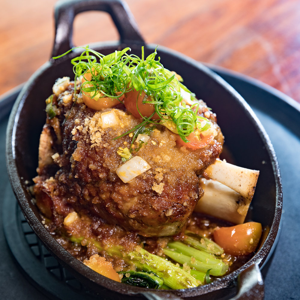 Eating House 1849_Brasied Berkshire Pork Shank |  Lilikoi BBQ Sauce, Ho Farm Lomi Tomatoes__pc Craig Bixel_20180119-AM9I9848-web.jpg
