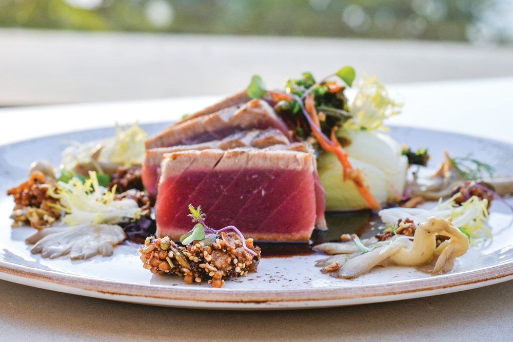 One of the items on the pupu menu is the blackened ahi, garnished with fresh pohole ferns grown locally on Maui.  Photo: Heather Ellison