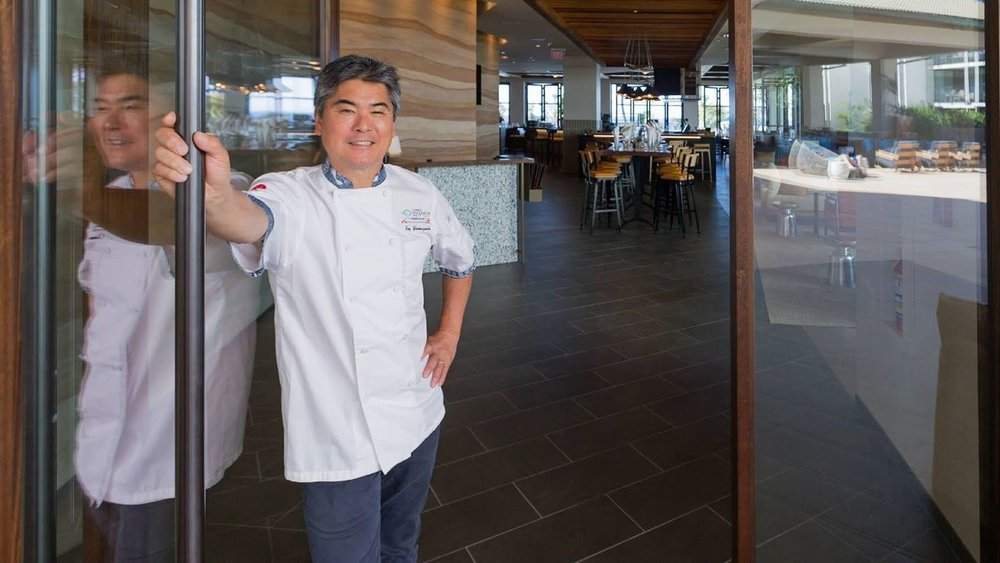 One of Hawaii's best-known chefs, Roy Yamaguchi, stands in the doorway of Humble Market Kitchin. Located in South Maui, it's Yamaguchi's newest creation.