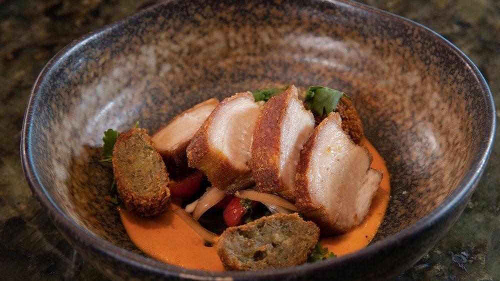 Crispy pork belly is one of the dinnertime appetizers at Goen Dining + Bar. (Craig Bixel)