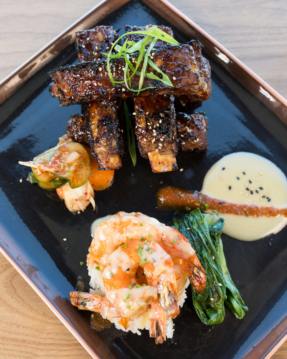 Roy's Hawaii_Dakine Combo | Grilled Szechuan Baby Back Pork Ribs, Teppan-yaki Shrimp, Firecracker Sauce__pc Craig Bixel_10-2017-6.jpg
