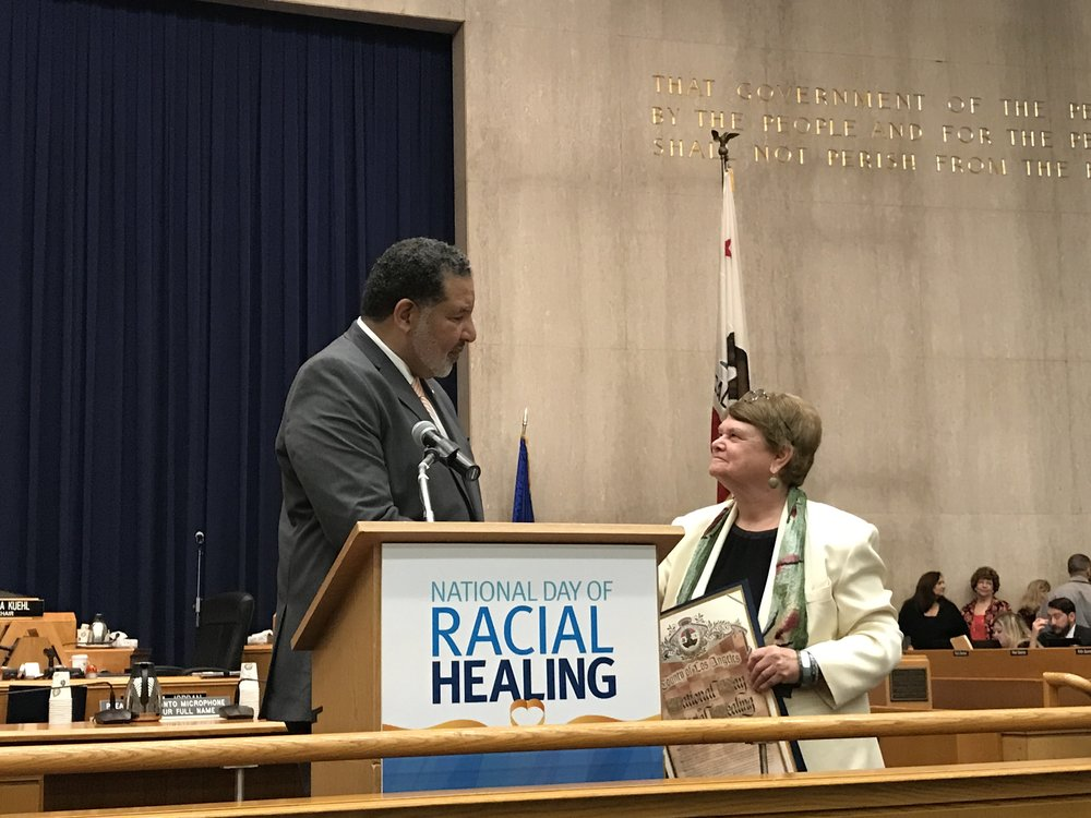The Reverend Alvin Herring of the W.K. Kellogg Foundation receives a proclamation from Los Angeles County Supervisor Sheila Kuehl.