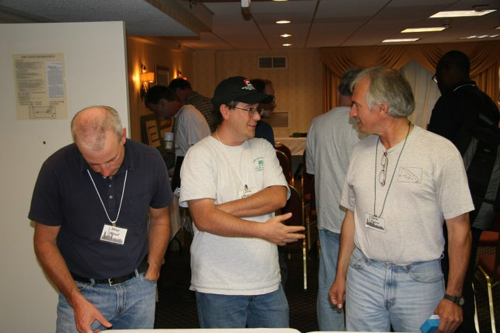 Mike Wood, convention host Chris Osterhus, and Gene Fusco