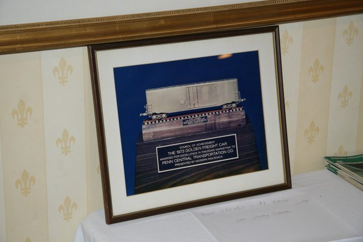 "A framed photo of the Penn Central's ""Golden Freight Car"" award"