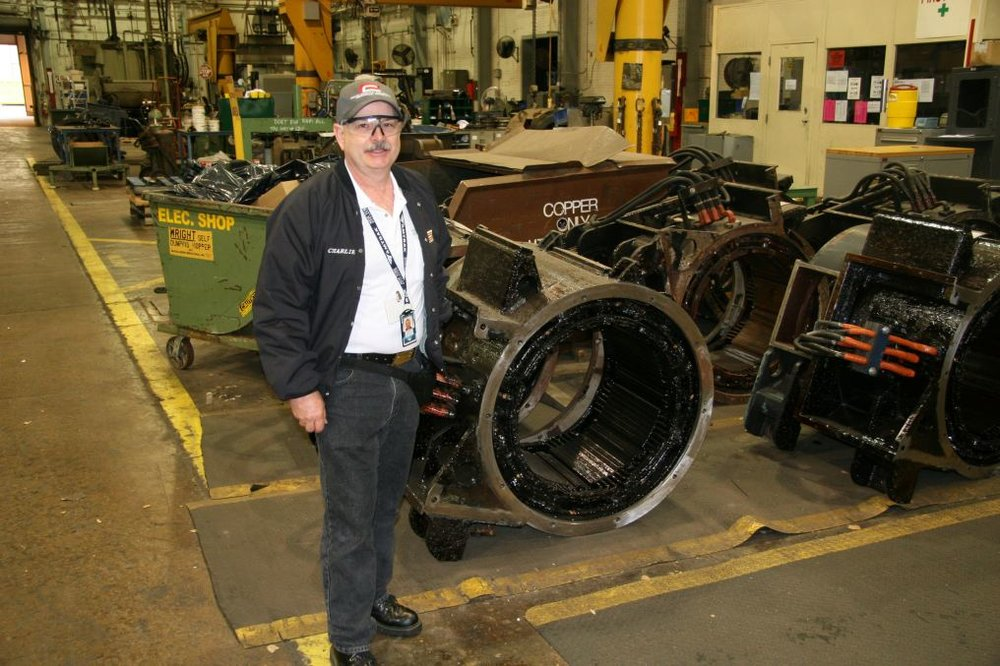 Chuck French next to some traction motor casings