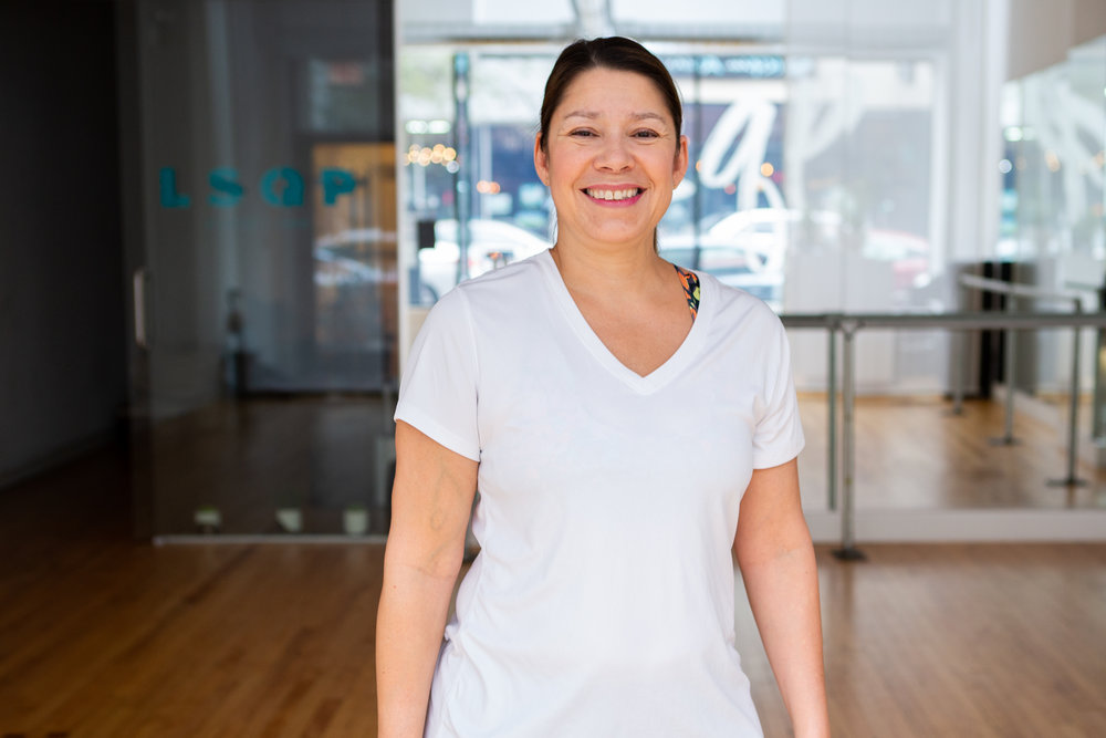 """Zoby S - """"Pilates makes me calmer and gives me better posture.I've injured myself at other gyms doing HIIT and kickboxing. At LSQP I get a great workout that is supported and safe, thanks to the specialized and knowledgeable instructors.LSQP is also women-positive and fun! I feel truly welcome and part of a community – it's unique from other places I've worked out."""""""