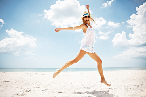 cheerful jump on beach.jpg
