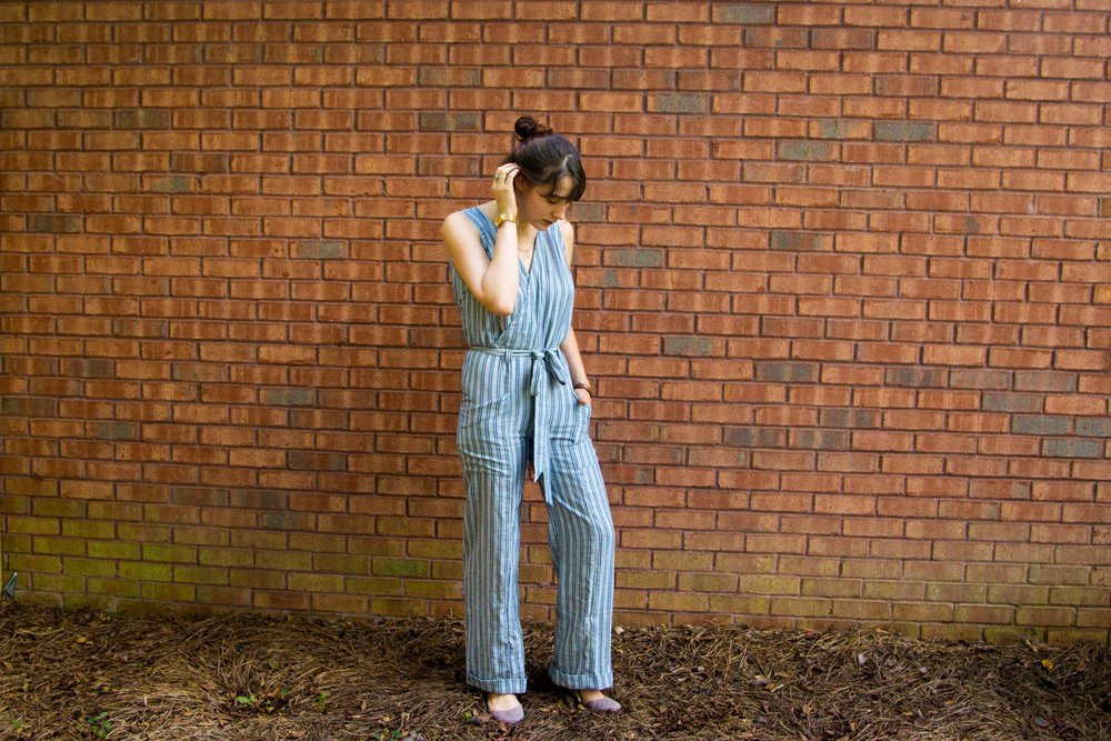 Women wearing a handmade blue and white striped jumpsuit