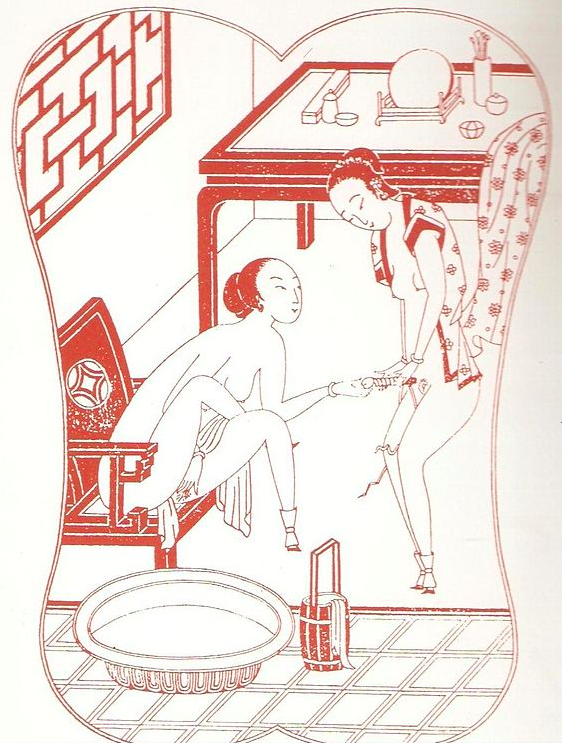 Two women using a dildo.