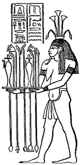 Hapi, God of the Nile, depicted as having both male and female presentation.