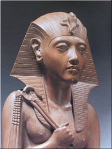 In this statue, hatshepsut lacks a beard but sports the royal cobra, headdress, and the crook and flail.