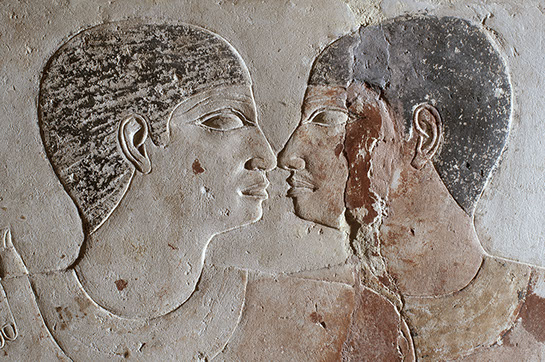Close up of Niankhkhnum and Khnumhotep nose kissing, one of the most intimate positions two people could have in Egyptian iconography.