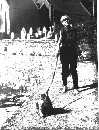 How can you not immediately fall in love with the kooky weirdo walking their cat on a leash in the cemetery!!