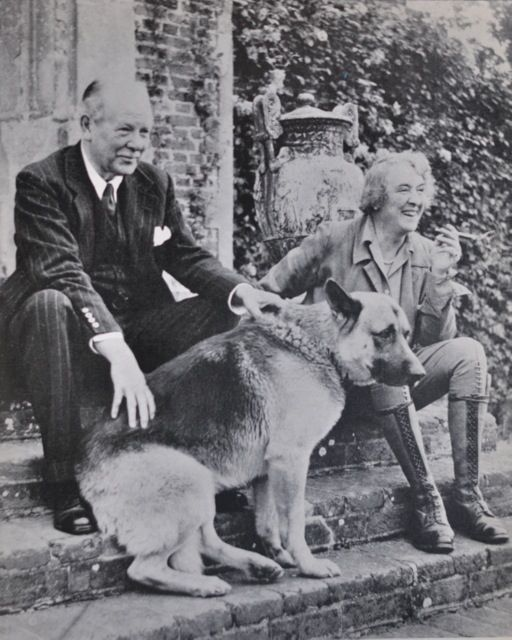 Vita Sackville-West and her husband Harold Nicolson at Sissinghurst with their dog Rollo.