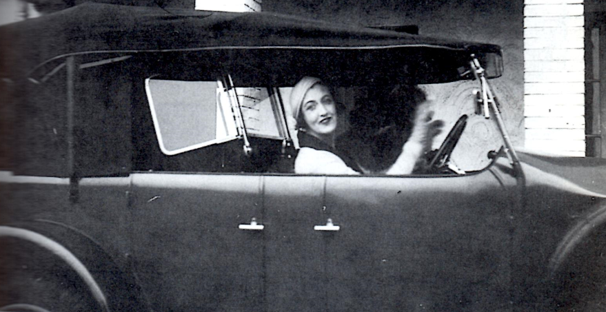 Dolly doing one of her favorite things, being behind the wheel. Date and photographer unknown.
