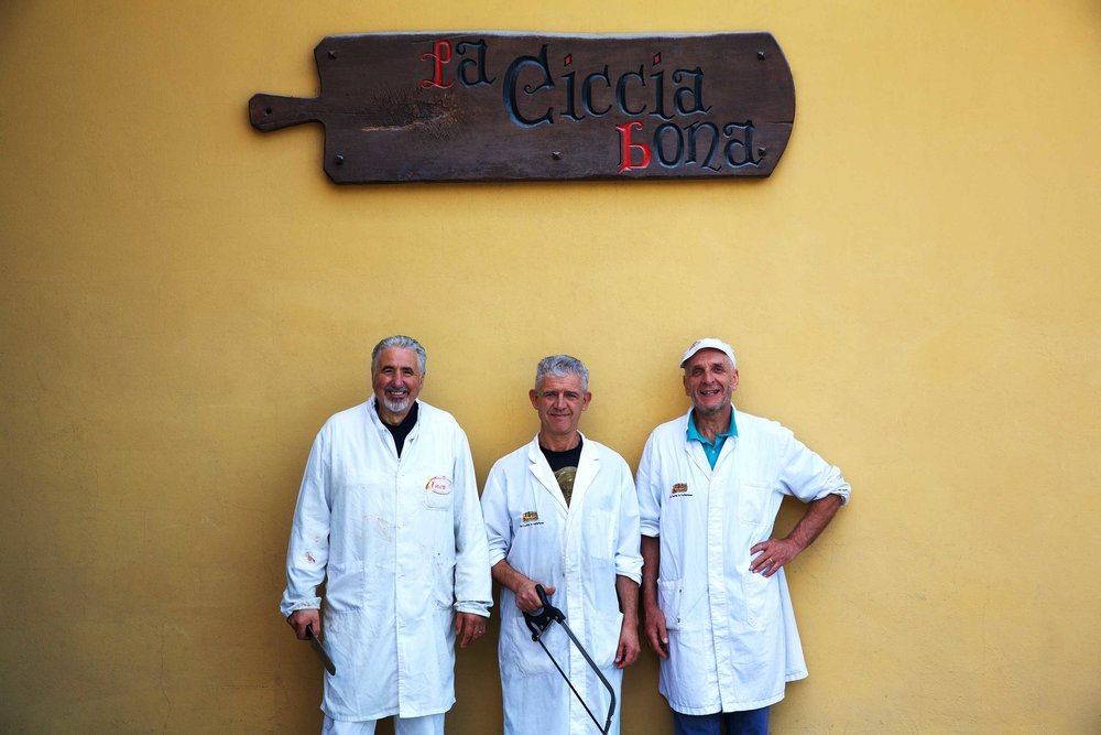 Butchers under their sign, 'A little fat does you good', Tuscany from a project I have been working on with chef Aurelio Barattini on a trattoria 'Antica Locanda di Sesto, Lucca