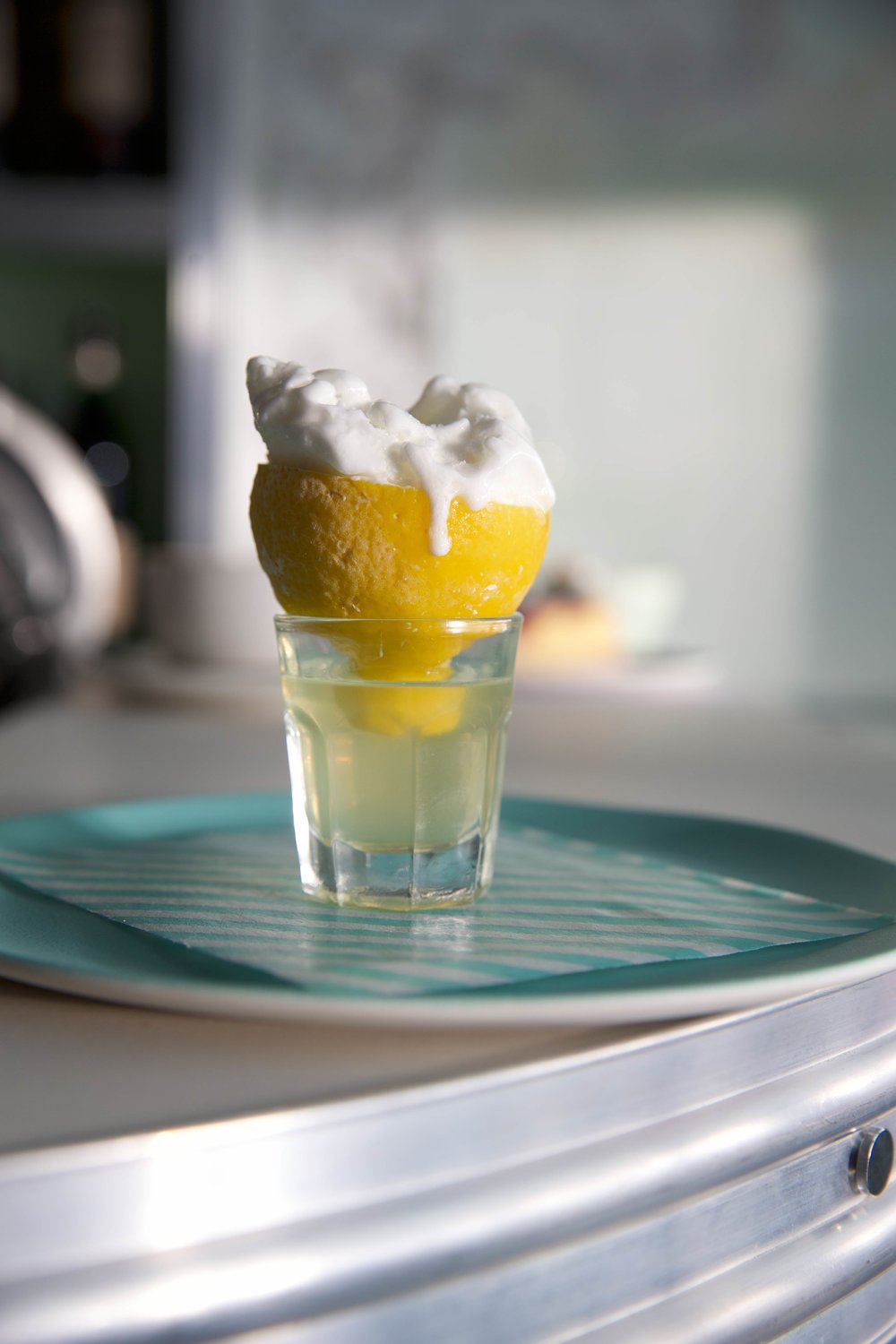 I love this dish, lemon sorbet served on a glass of lemoncello; such a wonderful simple execution