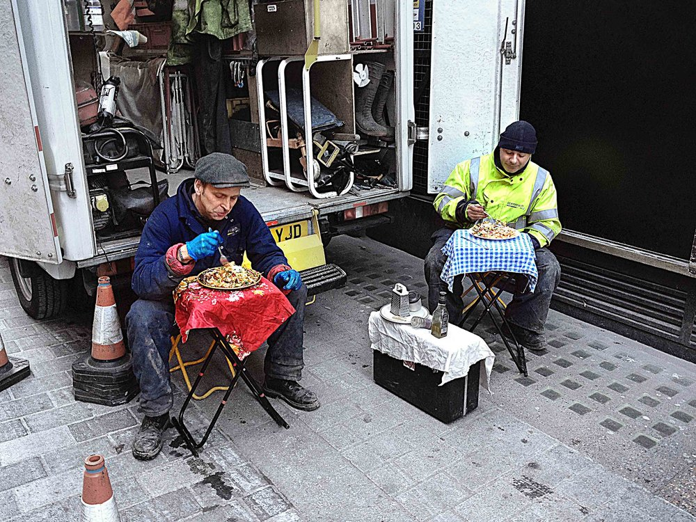 I really like this photo named 'Only Italians' because only Italians telecom workers would sit down at a table with table cloths in the middle of busy Soho, London.  The attention to detail for their lunch prep armed with parmesan & grater, pepper mill and surround sound!!  That's why Italians live longer…..!
