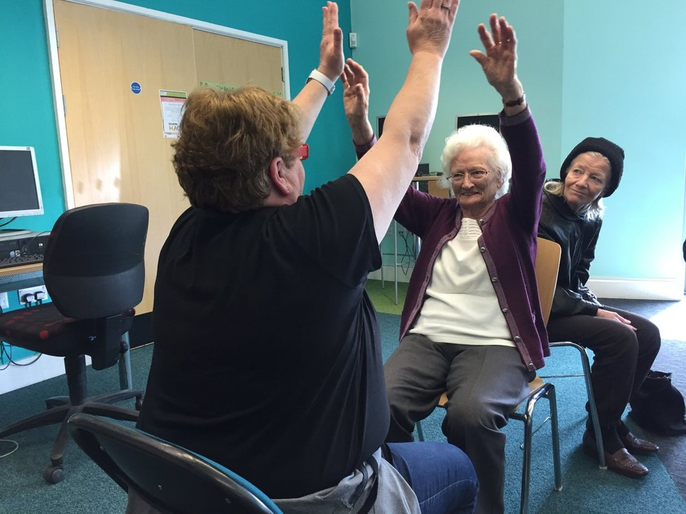 Participants and support workers making shapes together
