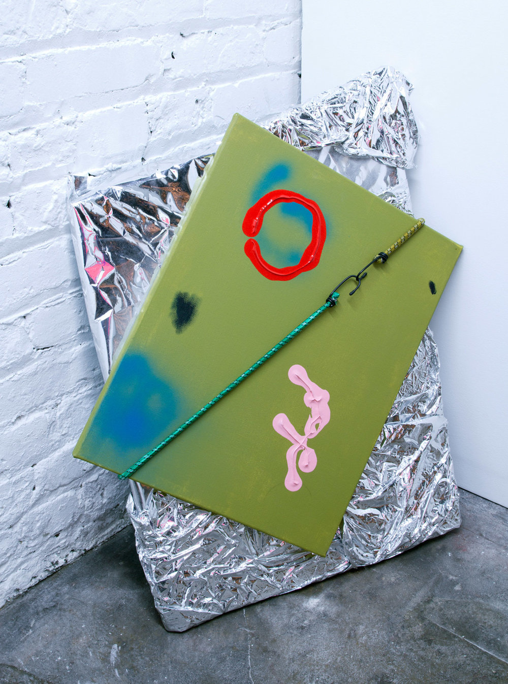 Green Painting with Circle , 2016, acrylic and spray paint on canvas, foam, reflective material, bungee cords Installed at Chamber, image courtesy of  Kyle Seis