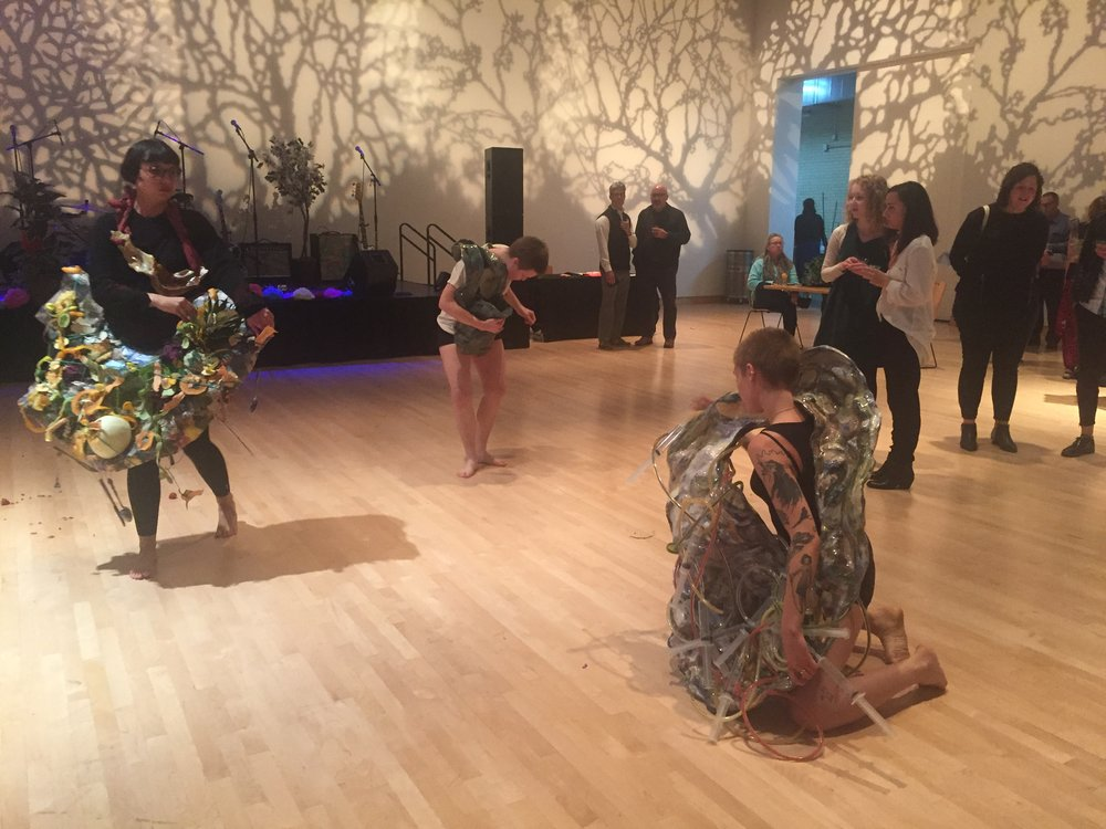 Performers activating Jessica Jackson Hutchins' sculpture work during the opening reception