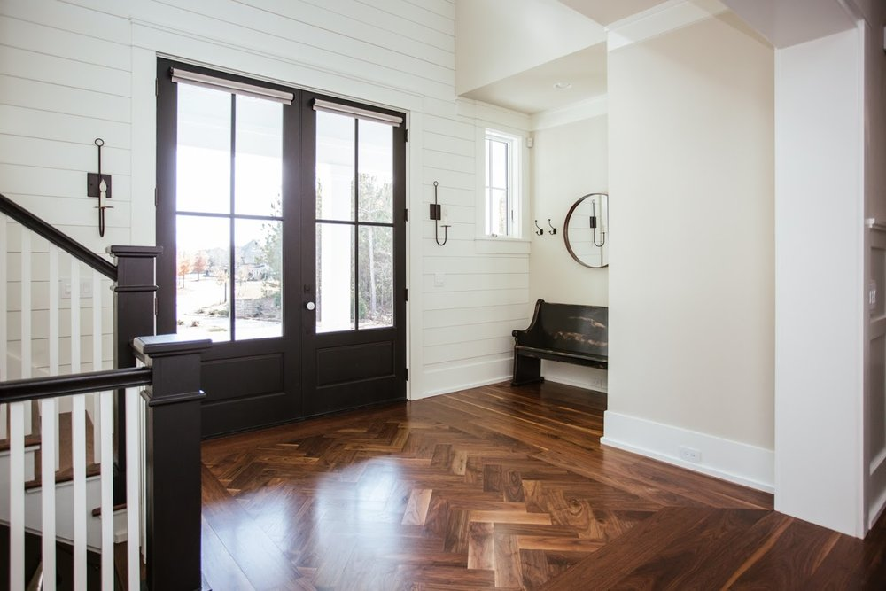 Wide Plank Black Walnut Flooring with Herringbone Detail