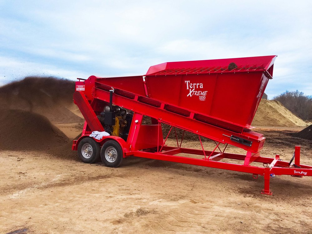 "Designed with the blended top soil business in mind, the 3200 works perfectly in the finishing of compost and manure products. The 3200 features a loading height of 8'3"", and a maximum processing capacity of 200 cubic yards per hour. The 3200 is the original model, still in production after 40 years and widely requested in the materials handling industry – this is a true and steady workhorse!"