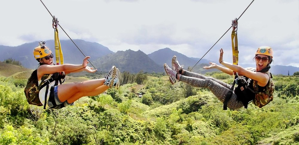 - Customers smile as the fly down the King Kong line at Princeville Ranch Adventures, Kauai, HI.