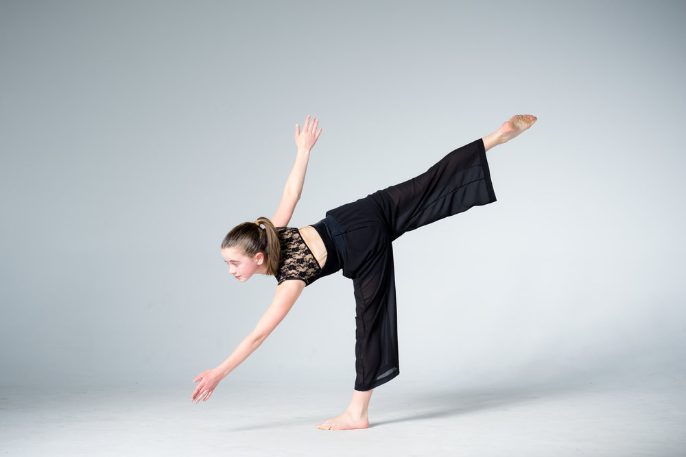 young modern dancer balancing on one leg