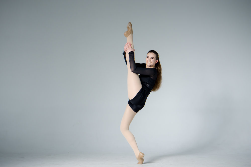 flexible jazz dancer with high leg kick