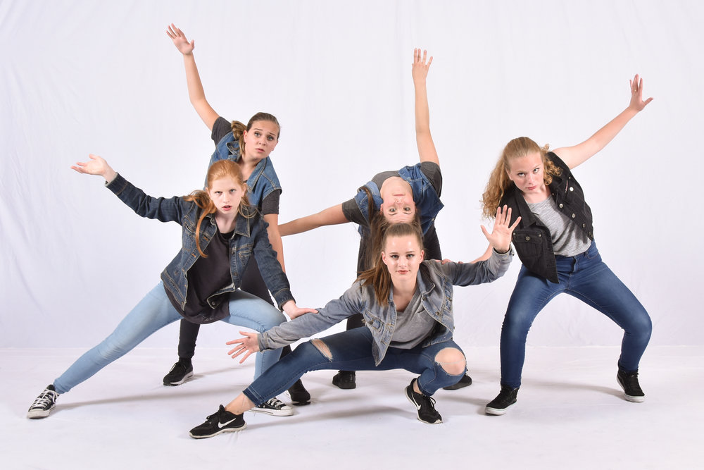 cool hip hop dancers in denim group pose