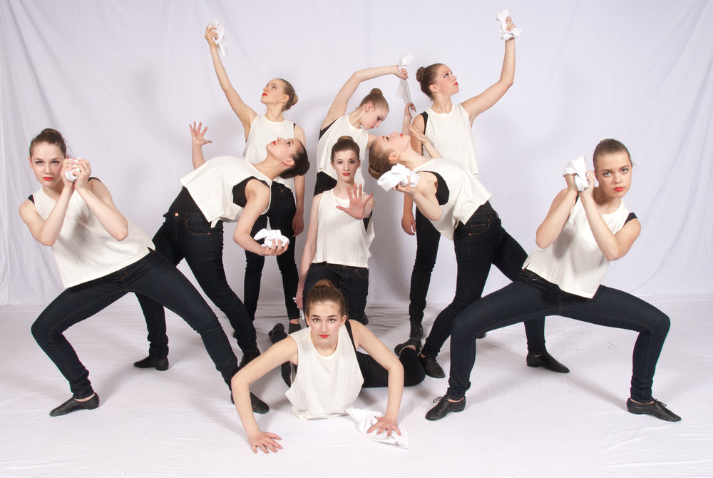 jazz dancers in exciting group pose
