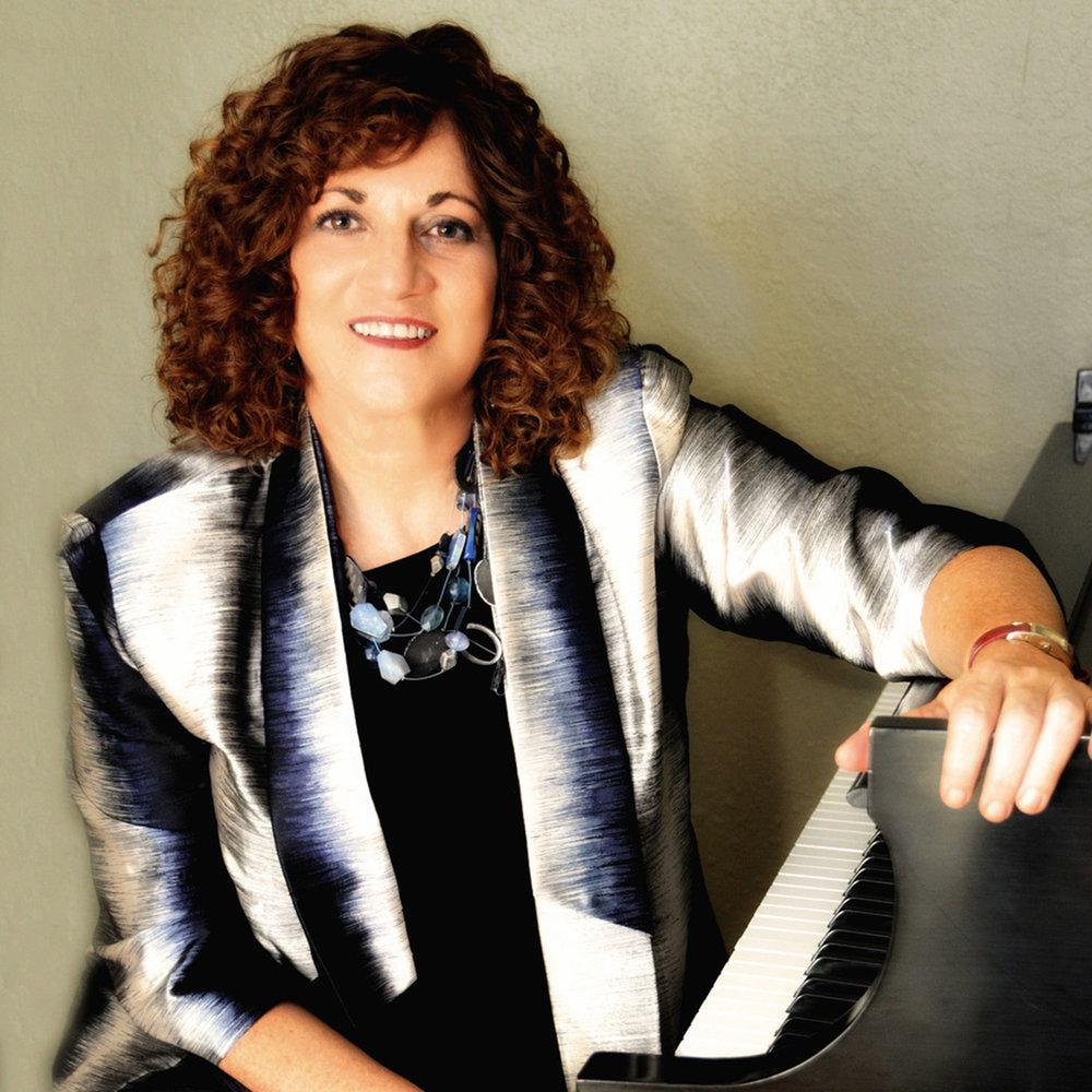 Linda Popky Headshot at piano (1).jpg