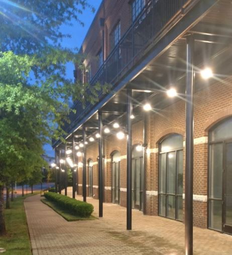 Jamison Station - Franklin, TN  Covered walkway LED lights fitted with occupancy sensors and daylight-dimmer controls to provide dim lighting during the night and brighten when homeowners appear.