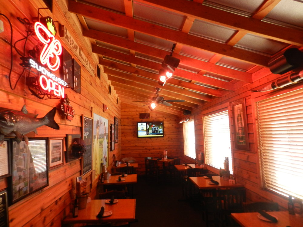 Texas Roadhouse's distinct warm and friendly environment - illuminated with pink LED lamps