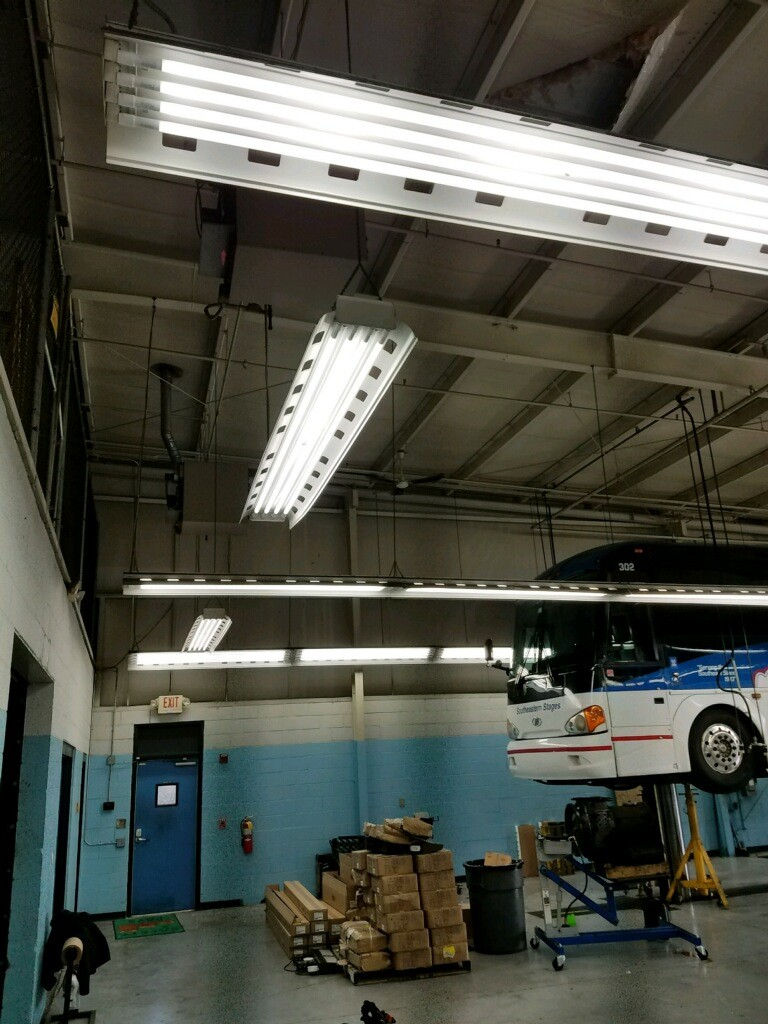 LIGHTING Solution - The fixtures were retrofitted with crisp, vibrant 5000K LED lamps with high CRI, providing greater contrast between subtle details and allowing intricate projects to be worked on with greater precision.TEU's main goal was to brighten the shop areas but at the same time doubled the light levels in the parking lot through fixture redirection and increased lumen output. Southeastern's lighting maintenance inconvenience was removed, freeing the technicians to focus on the upkeep of the motor coaches, thus increasing productivity and meeting the company's high standards for safety.