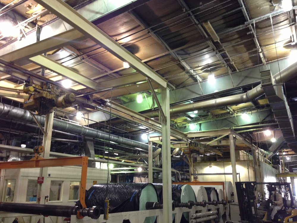 EXisting lighting - The lighting levels in the Ahlstrom plant ranged from 30 foot-candles (fC) under the older 1,000W metal halide bulbs up to 85fC under the newest ones. The uneven, multi-colored lighting had become unacceptable to management. TEU was selected for the project after some in-house testing.