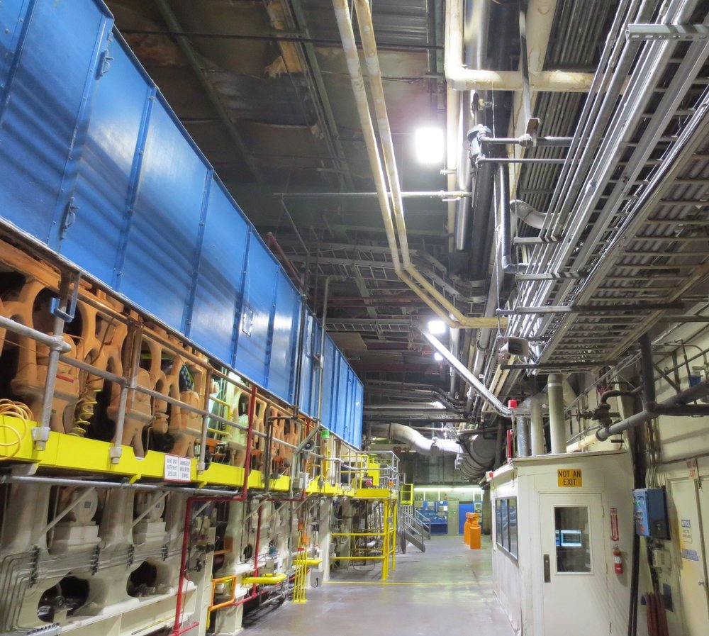 LIGHTING Solution - To provide the best solution, TEU's engineering team started with a photometric design that promised to deliver 55fC evenly throughout the facility. Since the maintenance crew at the plant had no experience with lighting designs or photometrics, TEU decided to conduct a pilot install. Upon completion of the pilot install, tests revealed that 57fC was achieved, exceeding the design by 2fC. 5000K LED highbay fixtures were installed in the entire facility, reducing the energy consumption by 71% and providing an even 57 foot-candle illumination.