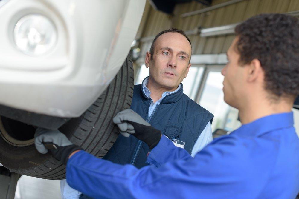 man-getting-car-brakes-checked