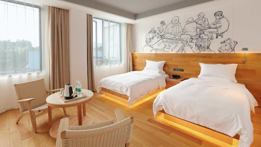 雅安蜀中驿瓦舍旅行酒店 - http://szy.travellingwithhotel.com/名山区陵园路122号雅安,四川前台电话: 0835-3226666  Email: yaan@travellingwithhotel.com